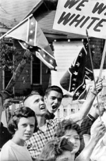 Birmingham, Alabama: Students wave confederate flags and carry anti-integration signs as they stage demonstration near West End High School, 9/11/63. It is the second day of integrated classes in Birmingham City Schools, 9/11/63.