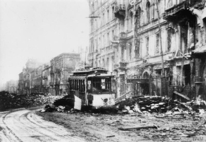 Burnt out tram amongst the ruins of Marszałkowska Street (looking south) in Warsaw after the Uprising's surrender. The building in the right foreground was Cinema Capitol on 125 Marszałkowska Street. Photograph probably taken on 20 November 1944. MH 4478 Part of HEYDECKER JOE JULIUS
